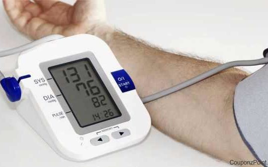 Man measuring high blood pressure at home